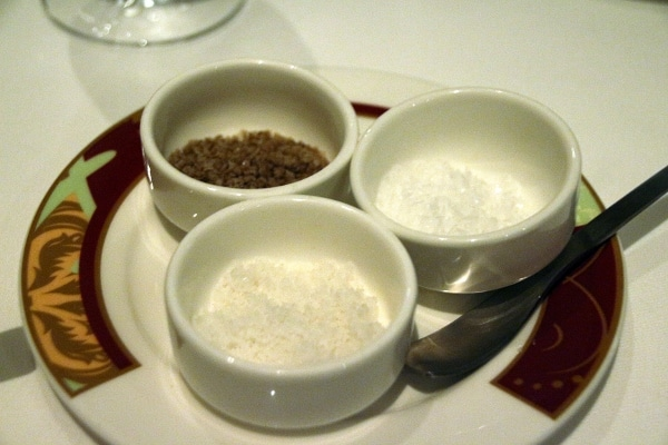 3 small dishes filled with different kinds of salt