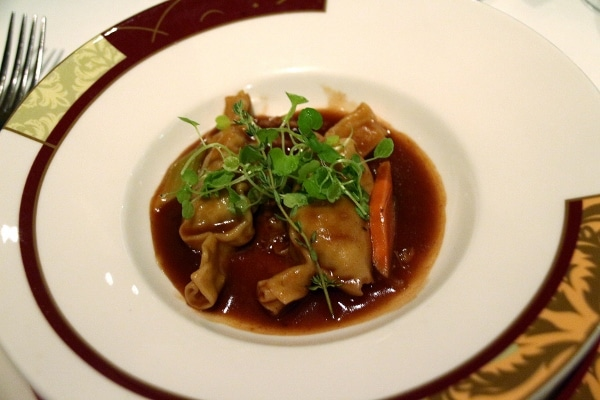 pasta parcels in a dark brown sauce