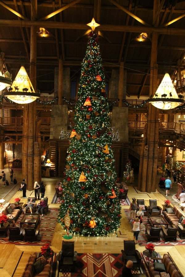 nighttime view of the giant Christmas tree in Disney\'s Wilderness Lodge lobby