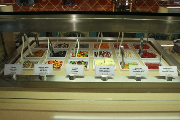 a variety of candies and toppings for ice cream
