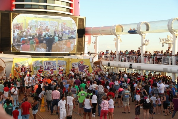 A crowd of people standing on the upper deck of the Disney Fantasy