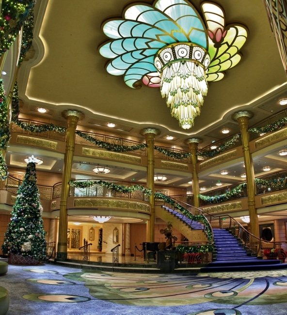 a wide view of the Disney Fantasy\'s lobby atrium decorated for Christmas
