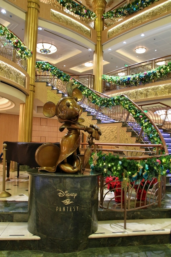 a closeup of a Minnie Mouse statue in the Disney Fantasy\'s lobby atrium