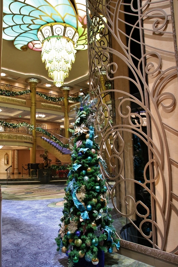 view of a small Christmas tree in the Disney Fantasy\'s lobby