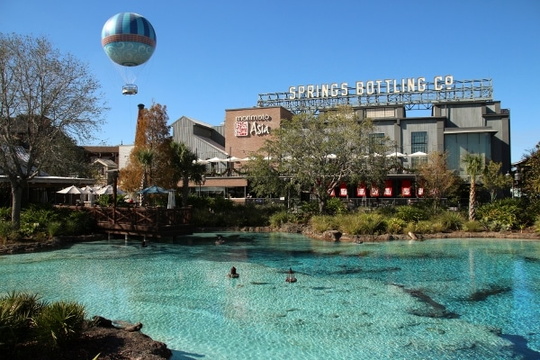 A pool of water in front of a building that says Springs Bottling Co