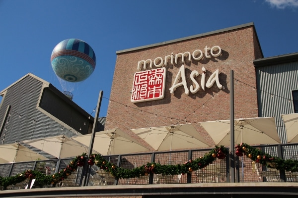 A sign on a building that says Morimoto Asia