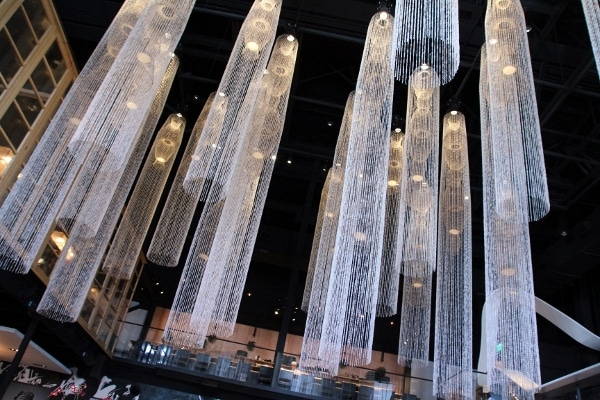 tall crystal chandeliers hanging in a restaurant