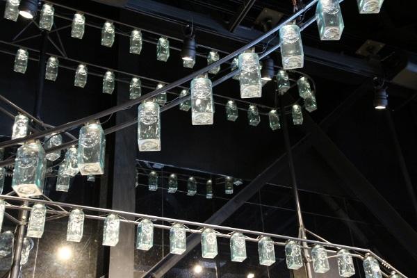 hanging bottles on display inside a restaurant