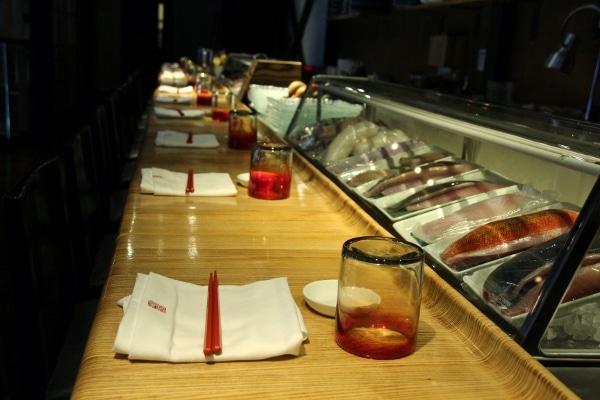a sushi bar inside a restaurant