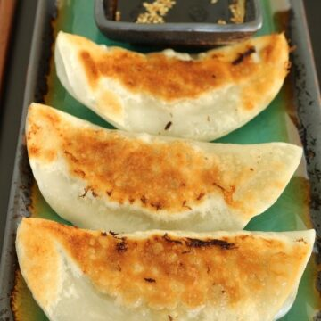 3 pan-fried dumplings with dipping sauce