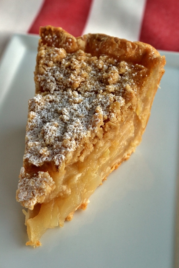 A close up of a slice of pear ginger pie