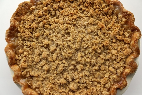 a baked pie with crumb topping