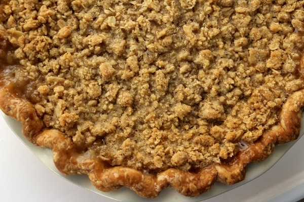 overhead view of a baked pie with oatmeal crumb topping