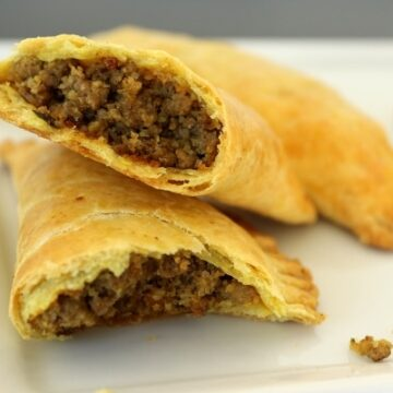 cross section of a Jamaican beef patty showing off the filling