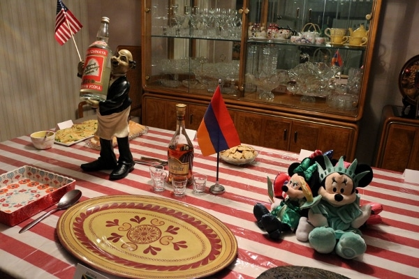 a table decorated with flags and Minnie Mouse dolls representing different countries