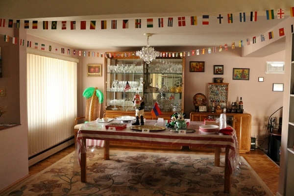 a dining room decorated with flags from around the world
