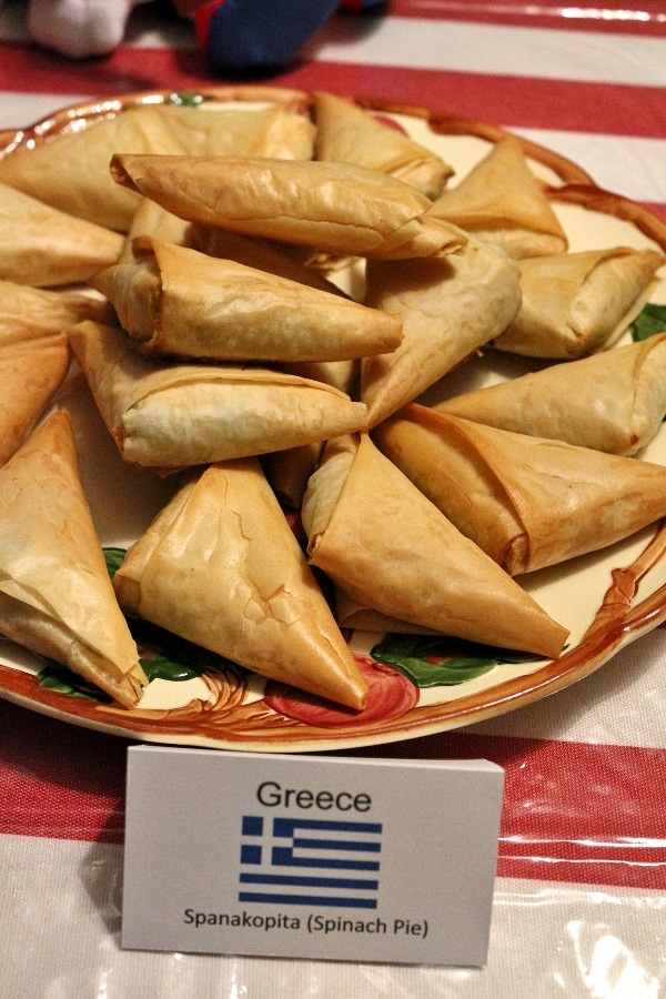 a platter of spanakopita triangles