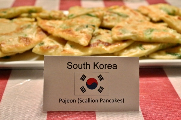 a small printed sign that says South Korea, Pajeon (Scallion Pancakes)