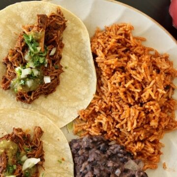 Shot-and-a-beer braised chicken tacos with Spanish rice, and refried beans