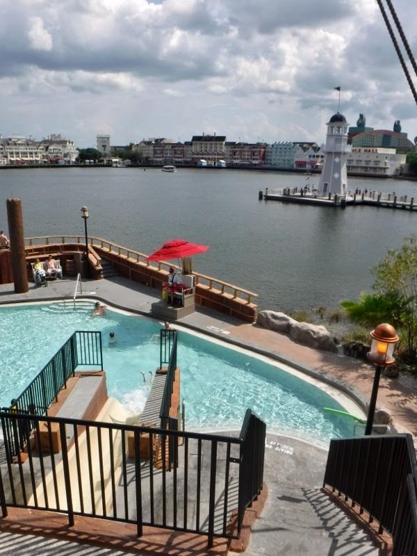 view of Disney\'s Boardwalk Resort from across the lagoon