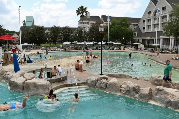 people swimming in the pools at Disney\'s Yacht and Beach Club Resorts