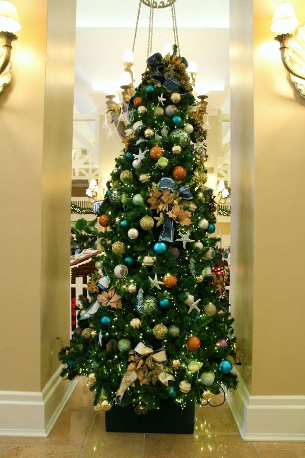a Christmas tree with nautical themed decorations