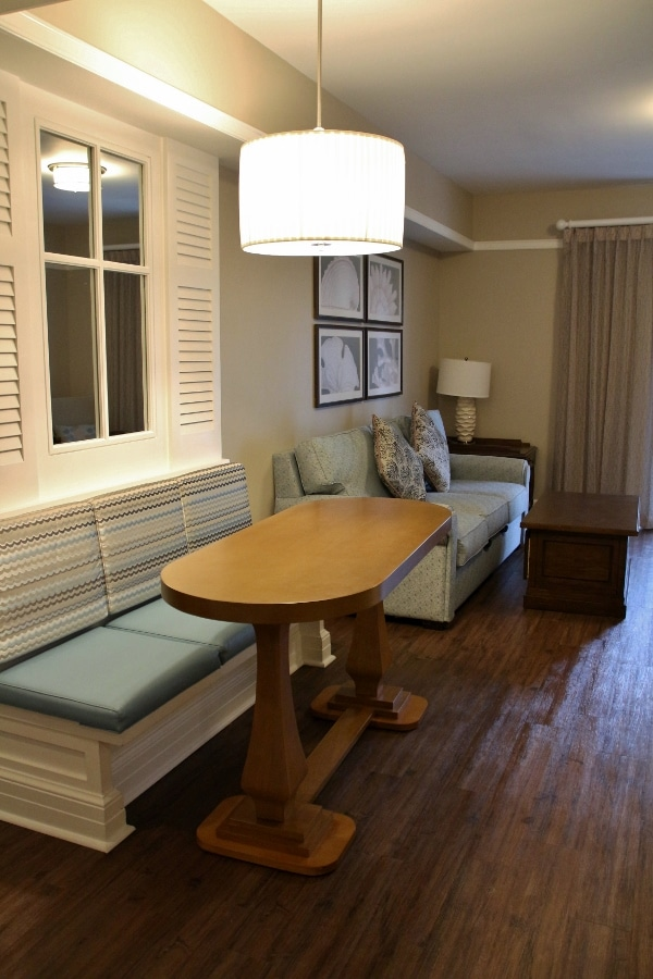 interior of a Disney Beach Club Villa room with a table and seating