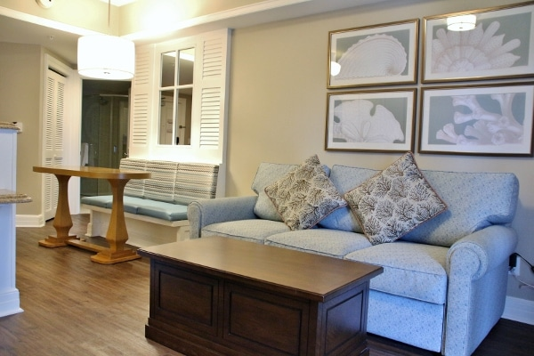 a sofa, coffee table, and small dining area