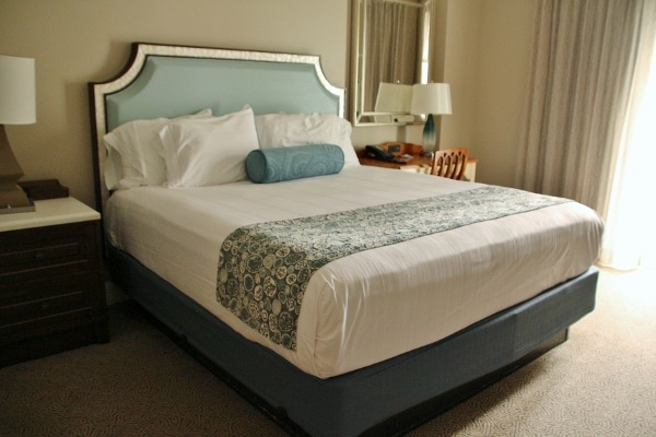 closeup of a large bed in a hotel room