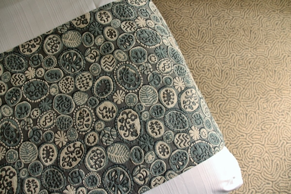 A close up of a bed runner