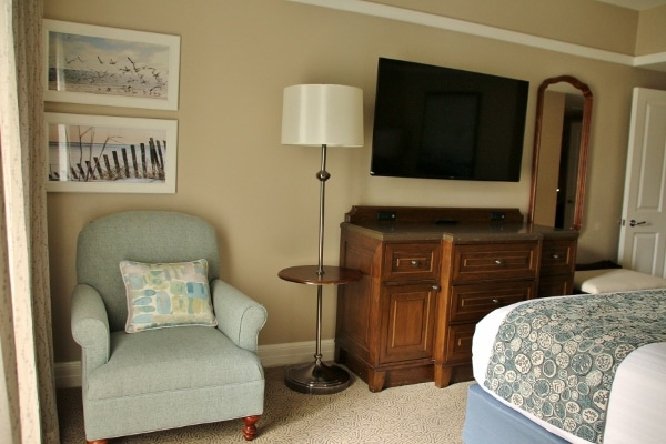 a chair and television in a hotel room