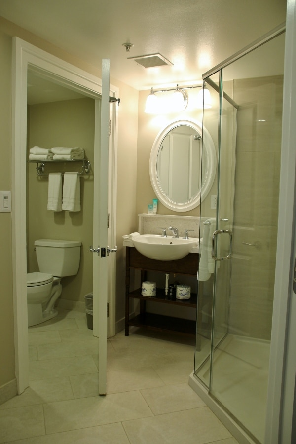 a toilet, sink, and shower in a hotel bathroom