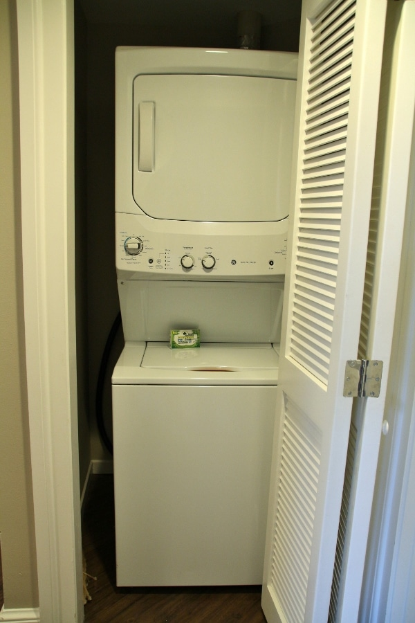a stacked laundry machine and dryer