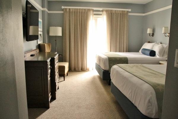 a hotel bedroom with 2 queen beds