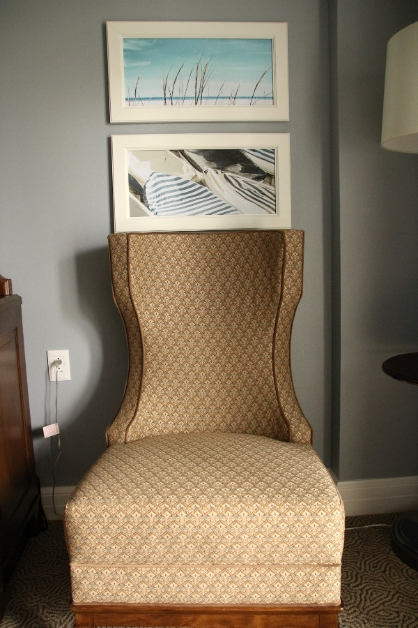 a comfy chair against a wall