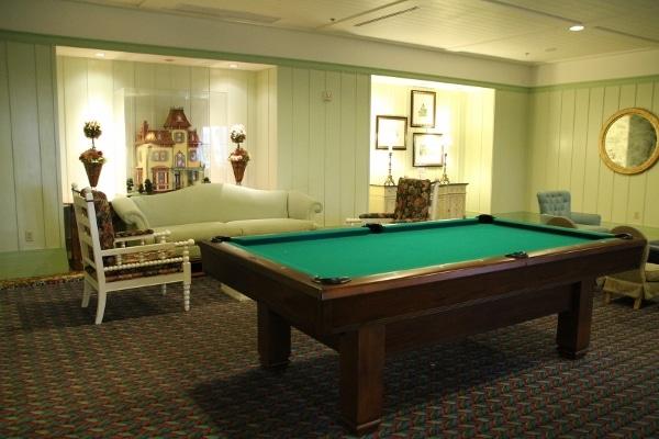 a room with a billiard table