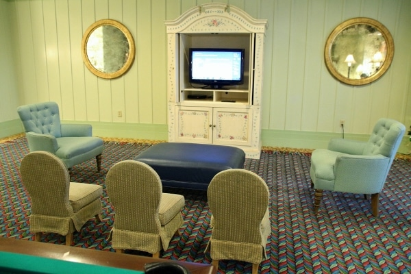 a small sitting area for children in front of a television