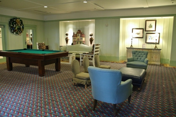 a sitting area and a billiard table in a large room