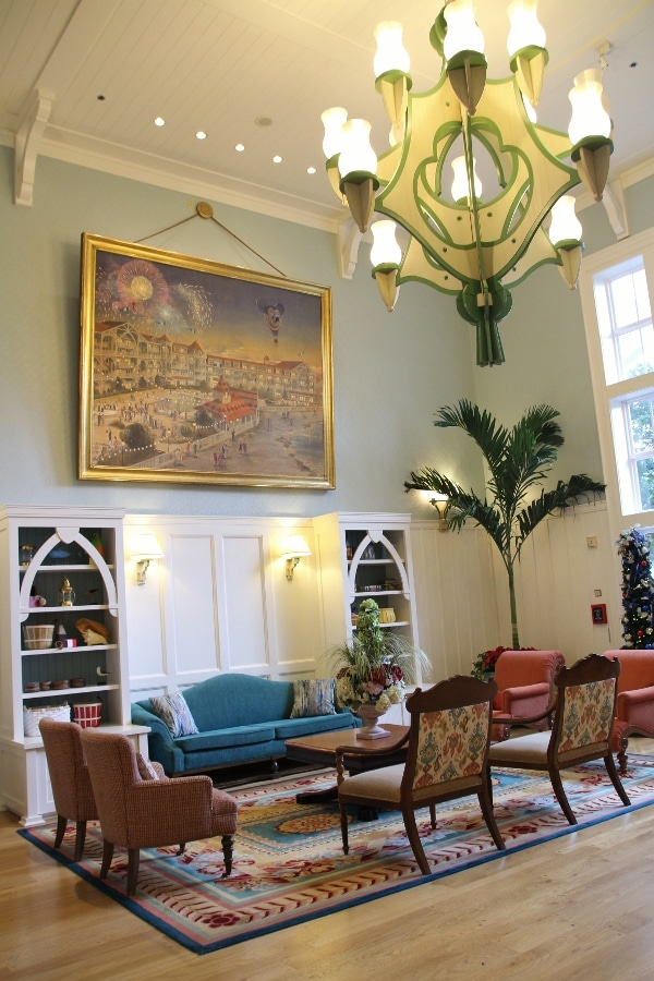 a sitting area with very tall ceilings