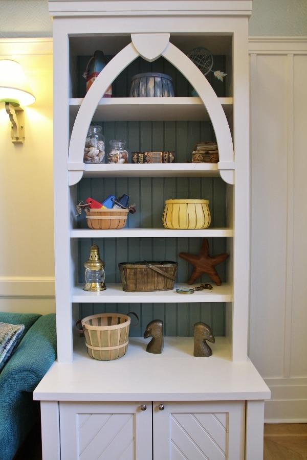 a bookshelf with colorful knickknacks