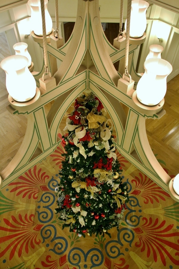 overhead view of a Christmas tree under a chandelier