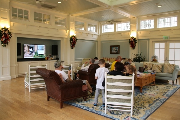 a group of people in a living room watching television