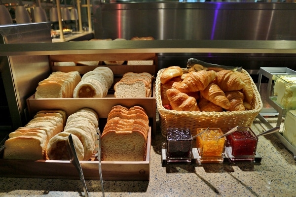 a variety of breads on a buffet