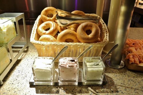 bagels with various spreads on a buffet