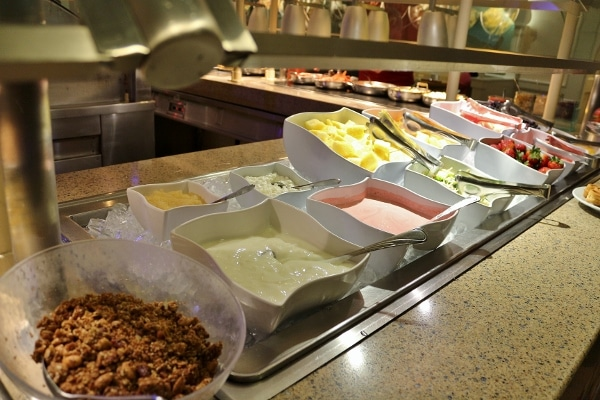 yogurts and fruits on a breakfast buffet