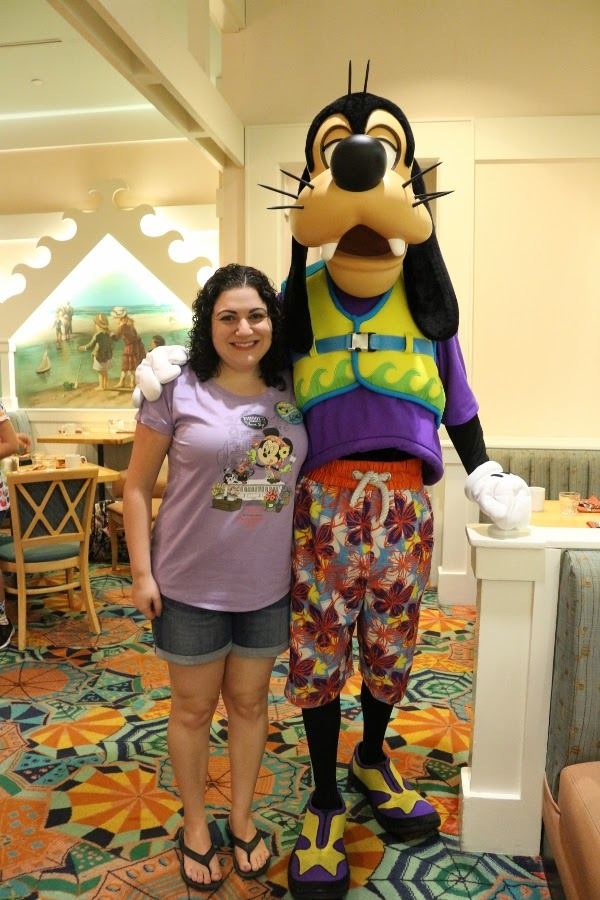 A woman posing with Goofy