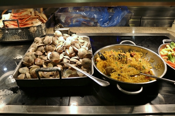 steamed clams and paella on a buffet