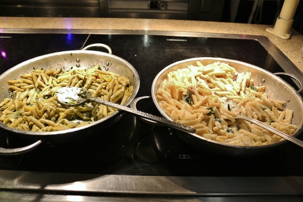 a couple pasta dishes on a buffet