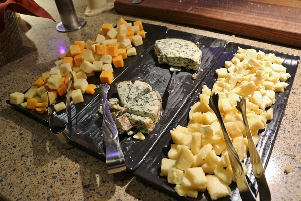 a variety of cheeses on a buffet