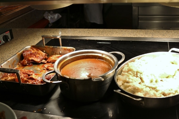 several pans of food on a buffet